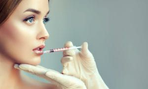 Woman looking off into the distance while getting a facial injection