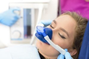 Female with a nose mask receiving nitrous oxide dental sedation