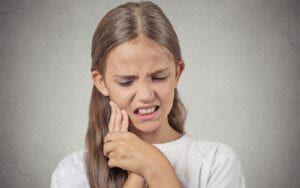 Woman experiencing sensitive teeth
