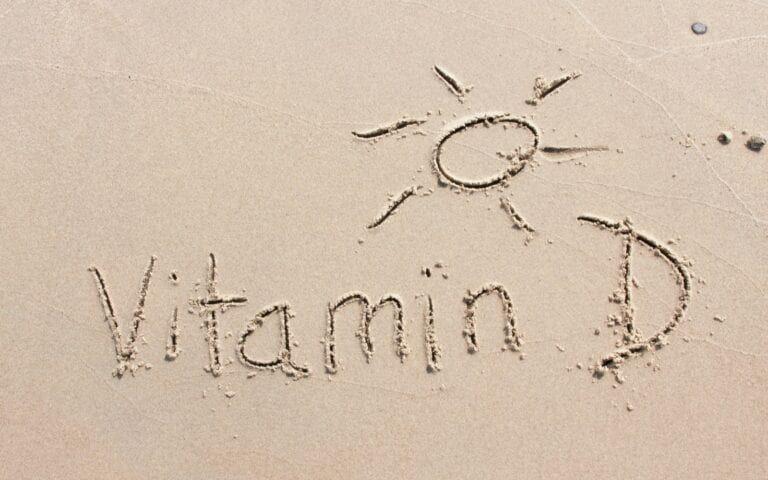 Vitamin D written in the beach